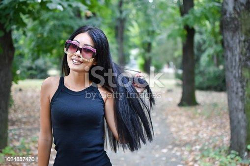 istock girl with sunglasses 1024887470
