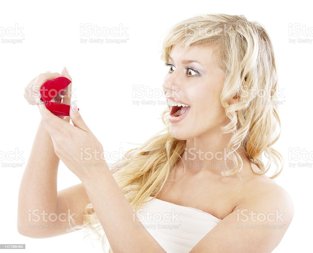Girl with surprise looks at box wedding ring royalty-free stock photo
