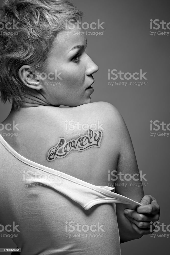 Girl with tattoo stock photo