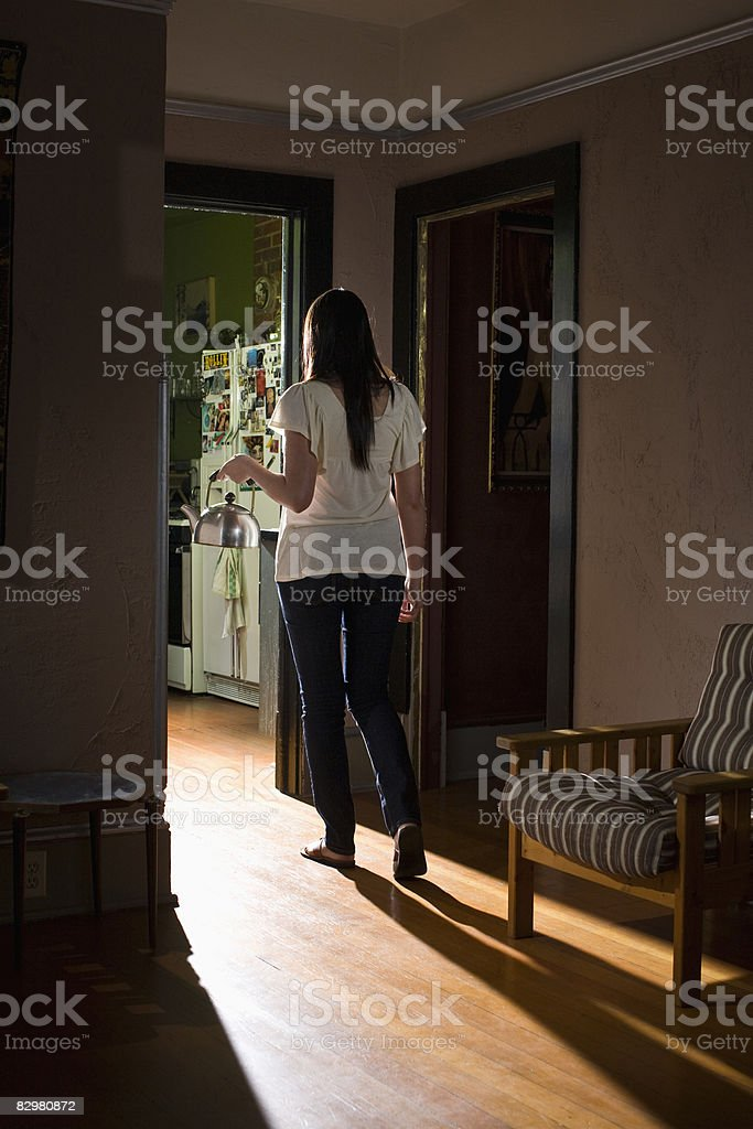 girl with tea kettle royalty free stockfoto