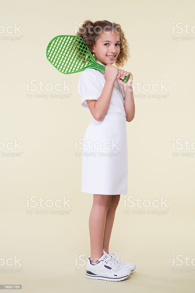 Girl with tennis racket 免版稅 stock photo