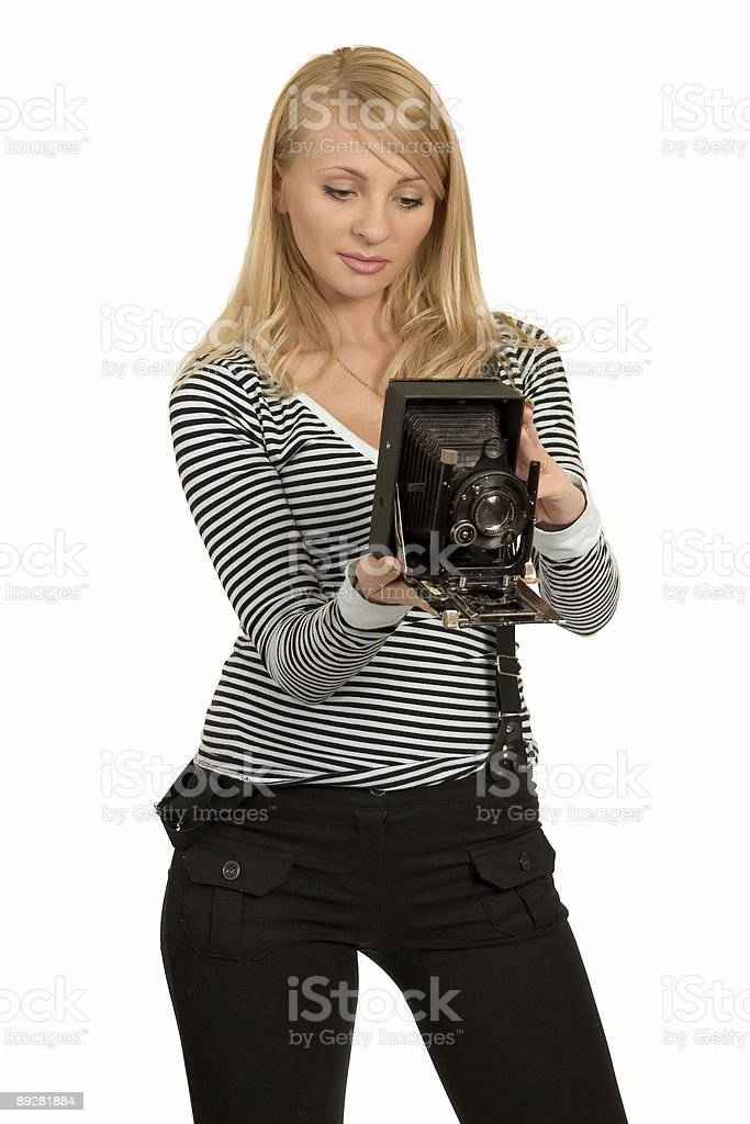 Girl with the antiquarian camera. stock photo