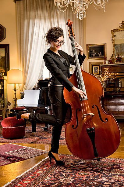 Girl With The Bass.Color Image stock photo
