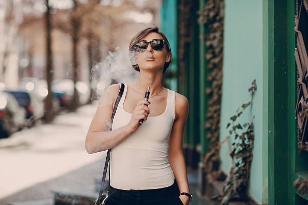 girl with the electronic cigarette stock photo