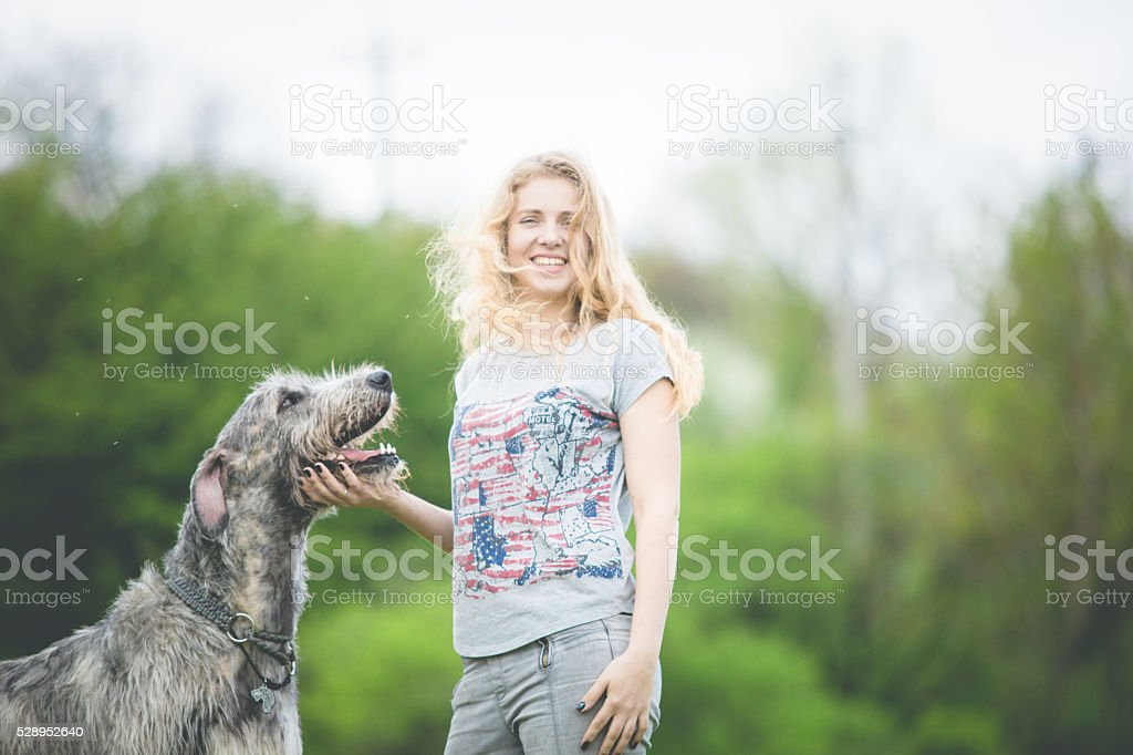 girl with the huge gray dog stock photo
