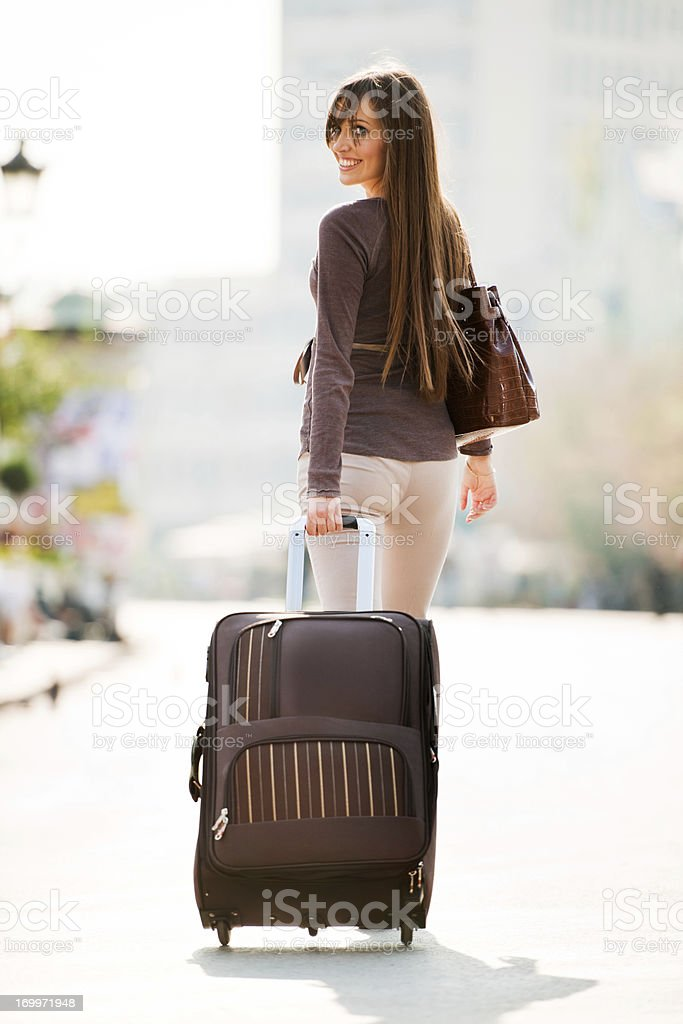 Girl with the suitcase. stock photo