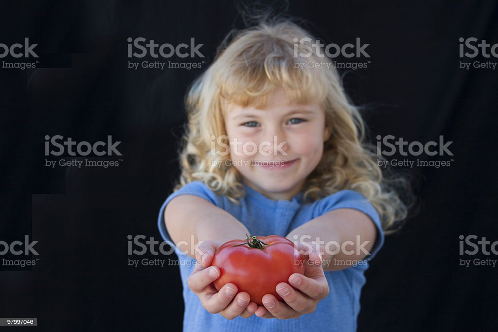 Girl with tomato royalty free stockfoto