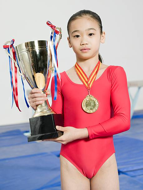 girl with trophy and medal - leotard stock pictures, royalty-free photos & images
