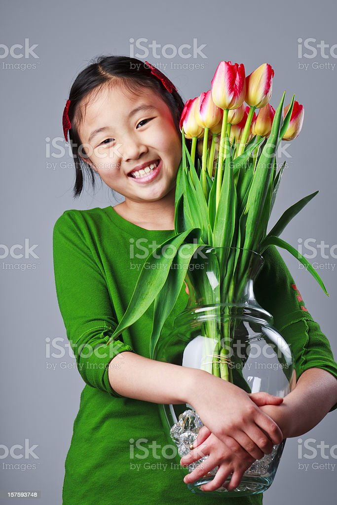 Girl with Tulips for Mom royalty-free stock photo