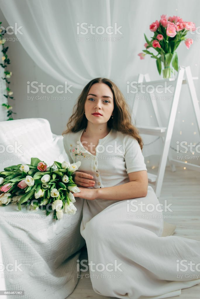 Girl with tulips foto de stock royalty-free