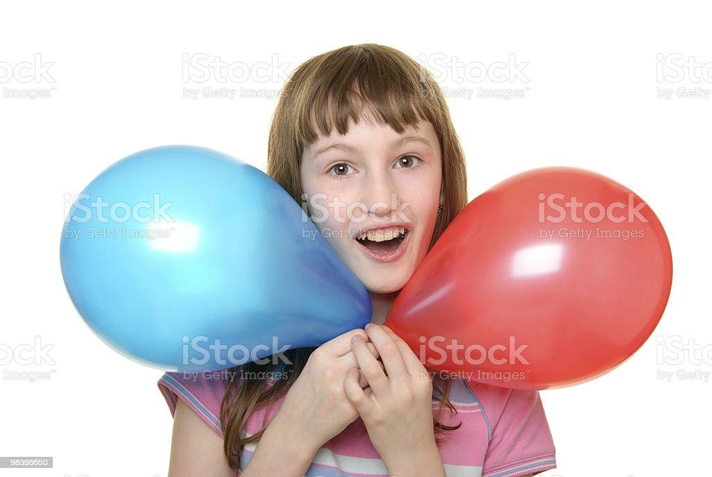 Ragazza con due palloncini di colore foto stock royalty-free