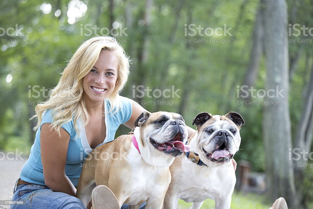 girl with two dogs royalty-free stock photo