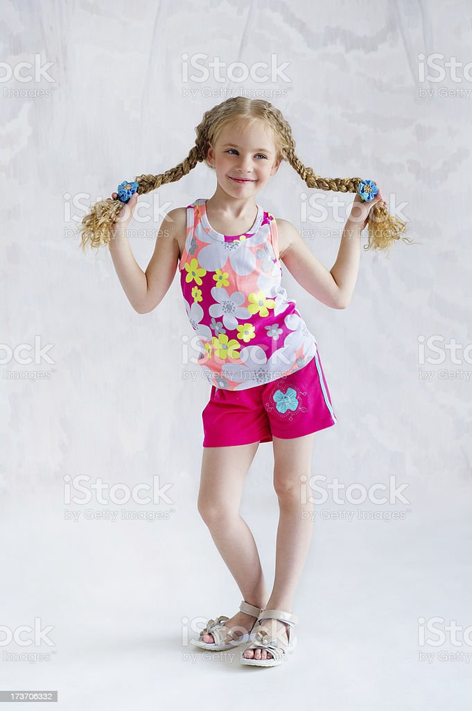 Girl with two funny pigtails royalty-free stock photo