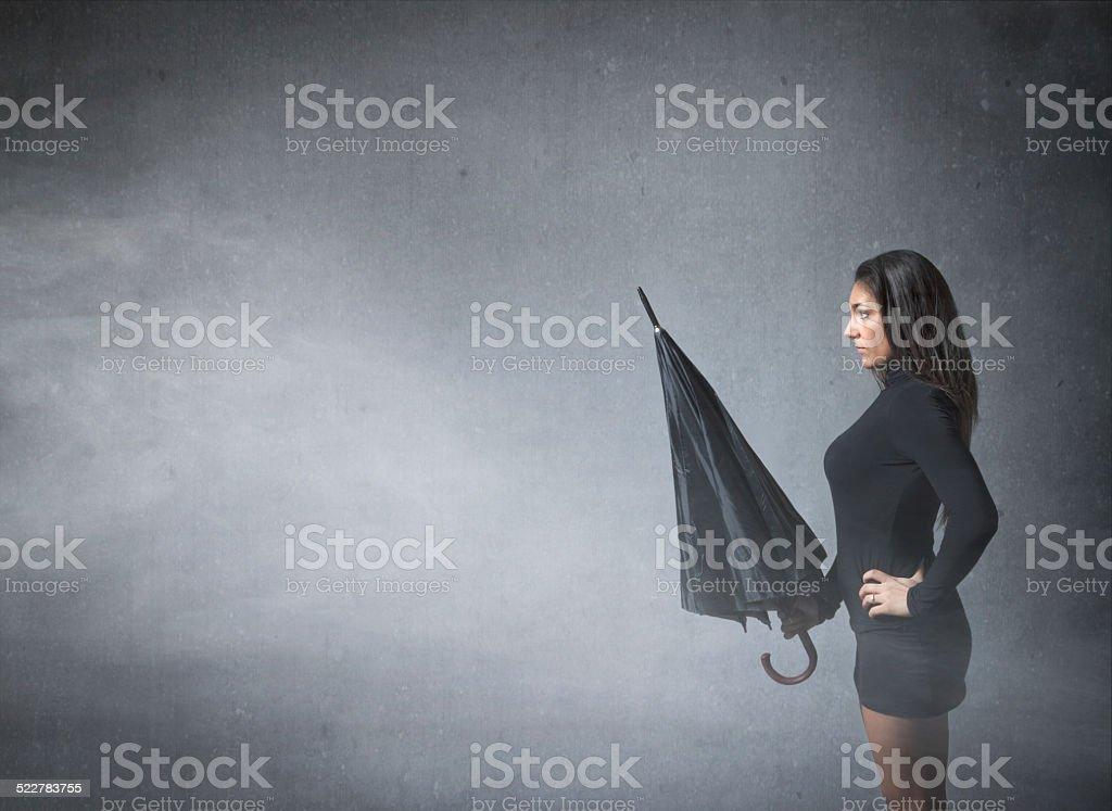 girl with umbrella in a profile side portrait stock photo