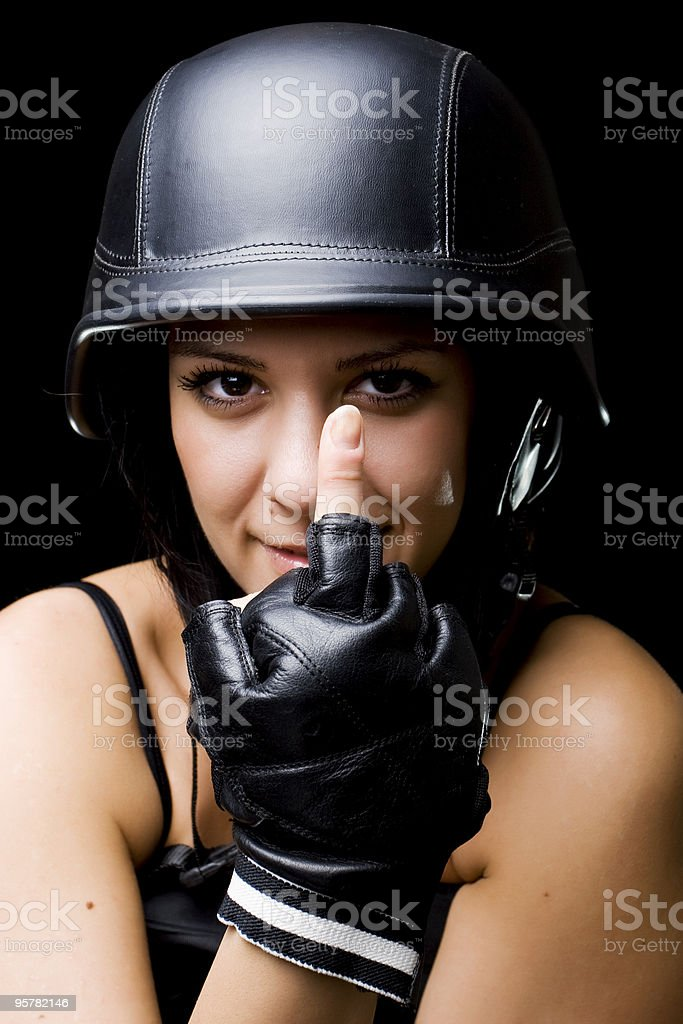 girl with US Army-style helmet, showing middle finger royalty-free stock photo