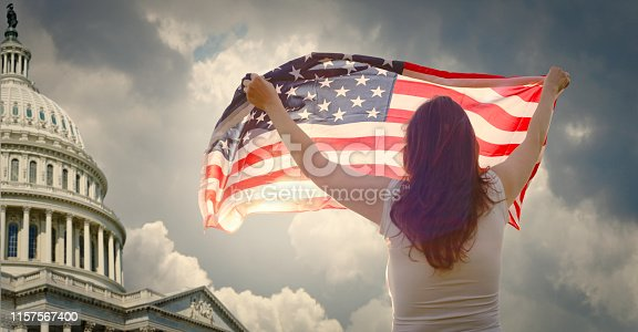 Girl with US flag at The Capitol in Washington DC