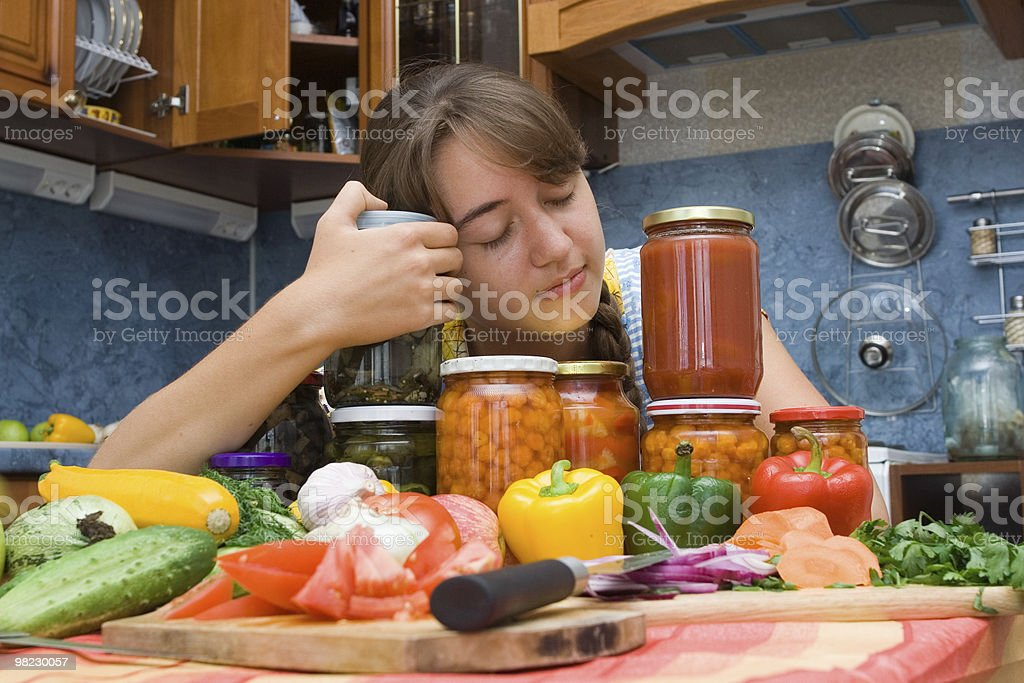 Girl with vegetables  in the kitchen royalty-free stock photo