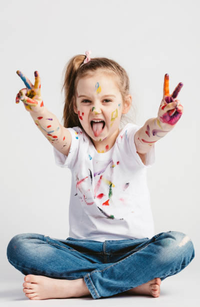Girl with victory sign sticking out her tounge A girl showing victory sign with her hand, sticking her tounge out. Rebel kid. sopaatervinning stock pictures, royalty-free photos & images