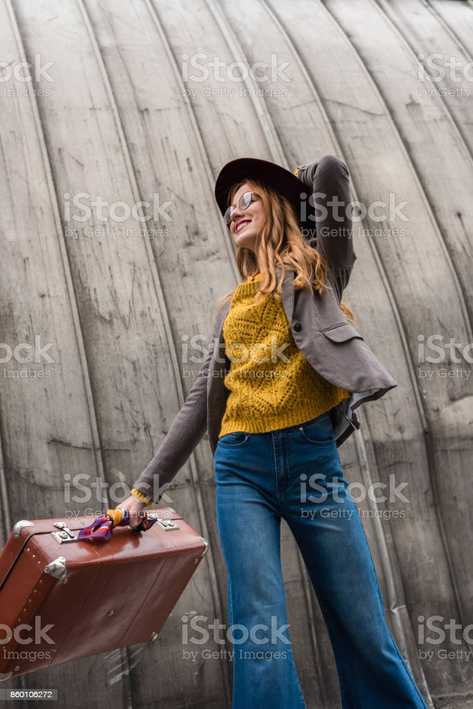 girl with vintage suitcase stock photo