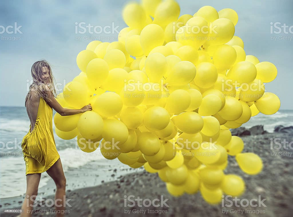 girl with yellow balloons stock photo