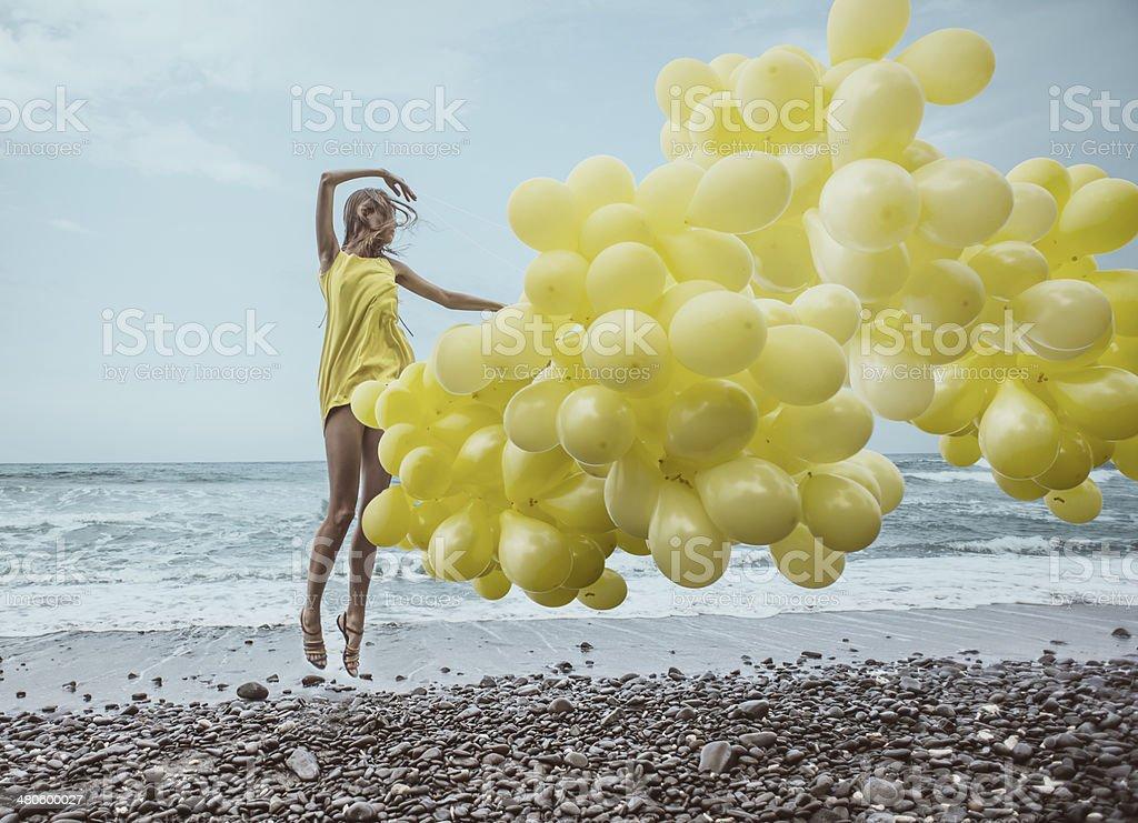 girl with yellow balloons stock photo