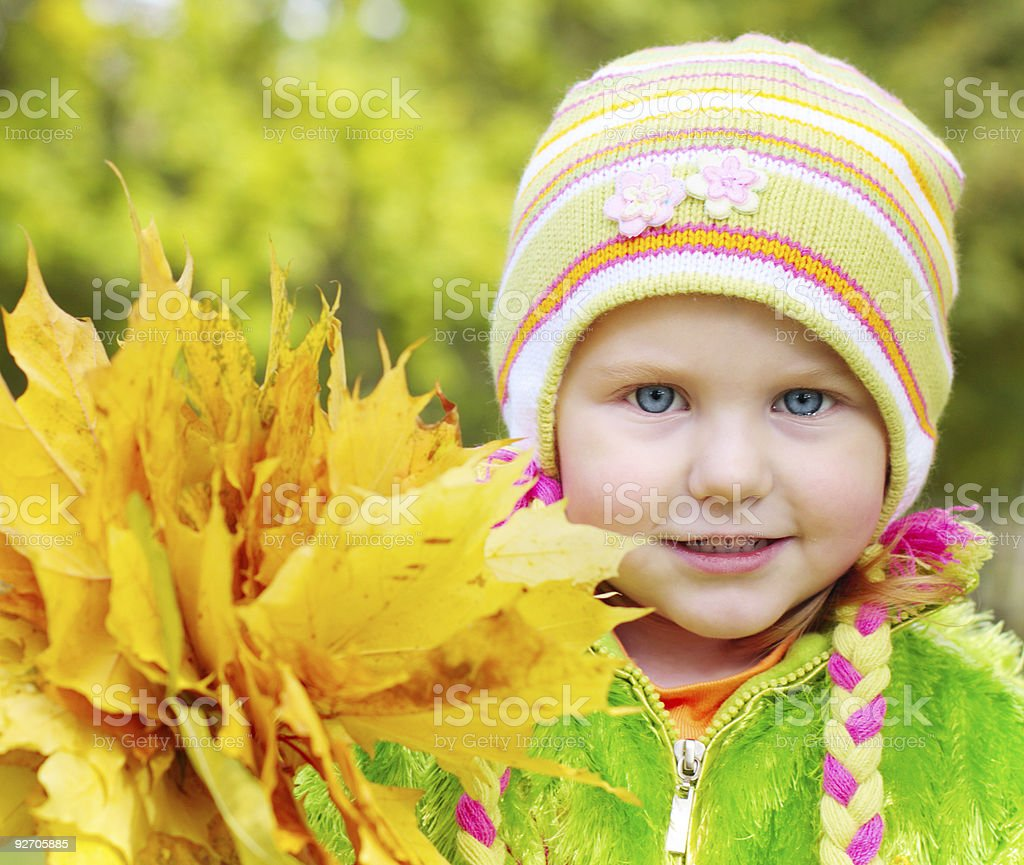 girl with yellow leaves royalty-free stock photo