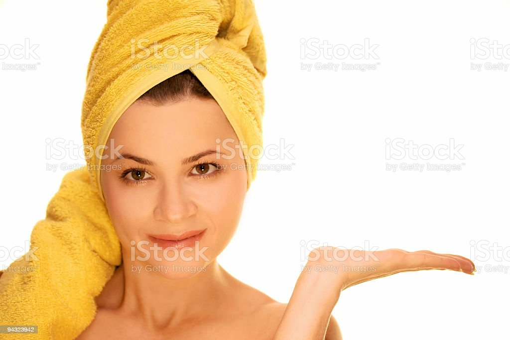 Girl with yellow towel advertises royalty-free stock photo