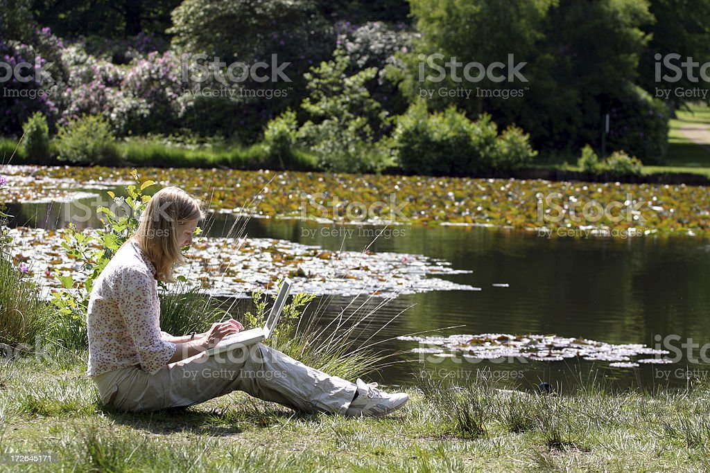 Girl working by pond royalty-free stock photo