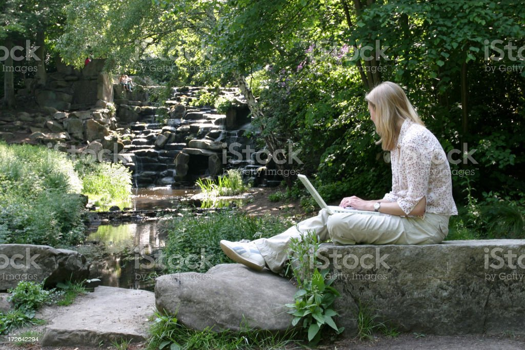 Girl working by waterfall royalty-free stock photo
