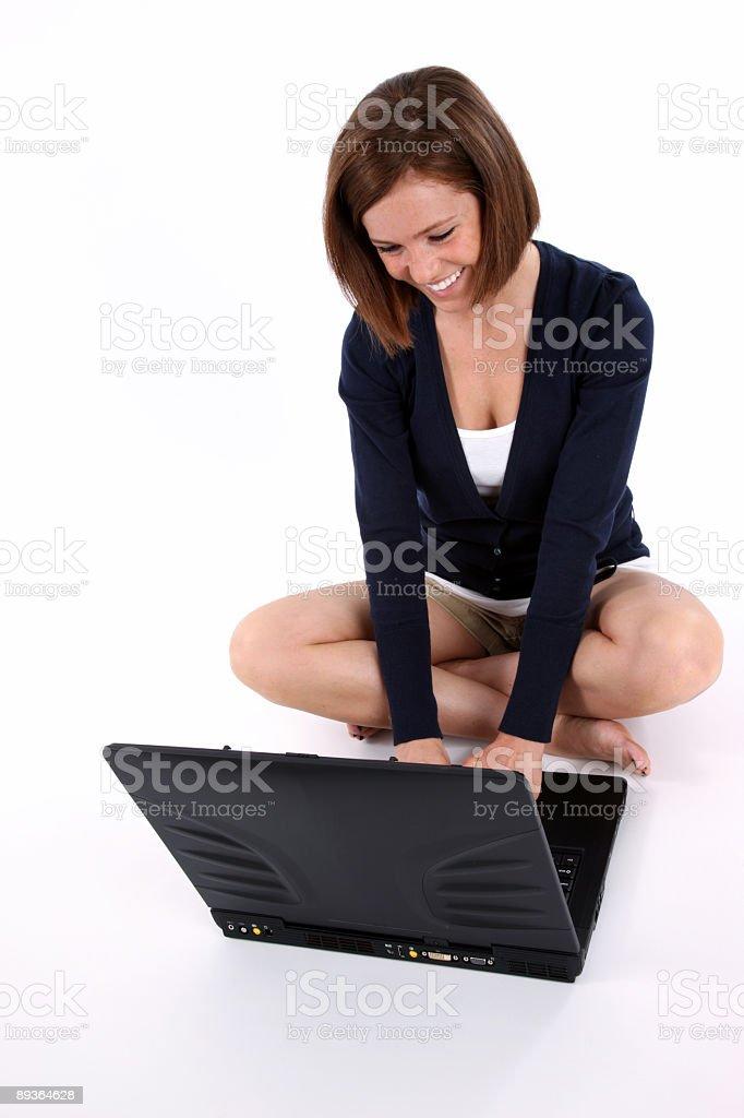 Girl working her a laptop royaltyfri bildbanksbilder