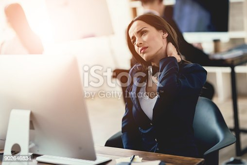 istock A girl working in the office feels tired. 902646834