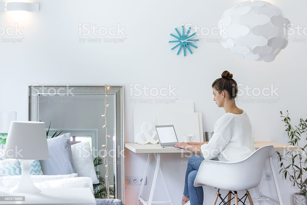 Girl working on laptop stock photo
