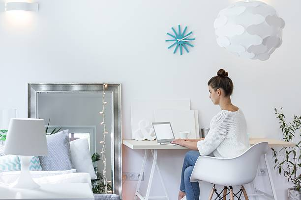 Girl working on laptop Girl working on laptop in white room bachelor stock pictures, royalty-free photos & images