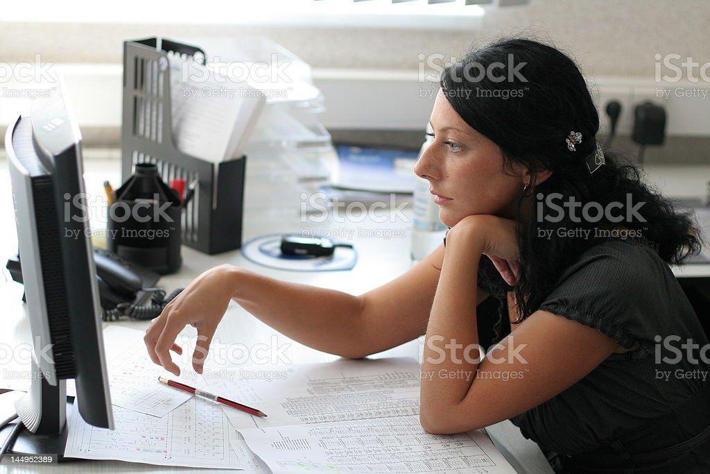 Girl works in office stock photo