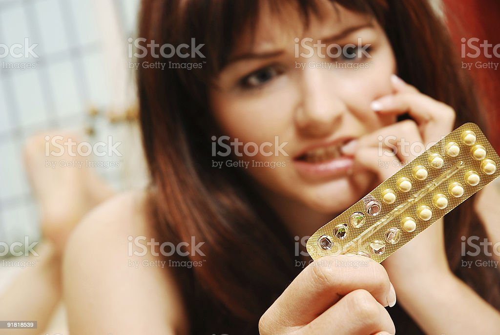 Girl worrying about her contaception stock photo