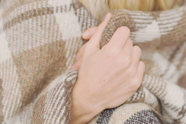 Girl wrapped in a warm wool plaid if natural colors Girl wrapped in a warm wool plaid if natural colors wrapped in a blanket stock pictures, royalty-free photos & images