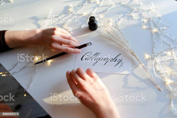 Girl writes pen fountain calligraphic letters sitting at table picture id836583074?b=1&k=6&m=836583074&s=612x612&h=zui3tkc7sxpylyagppeegc6cwc1cq4uibup  fzrhno=