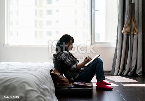 istock girl writing and drawing on digital tablet in bedroom 994789938