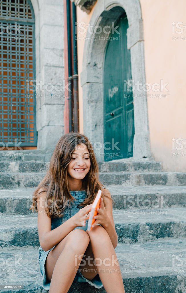 Girl writing Diary stock photo
