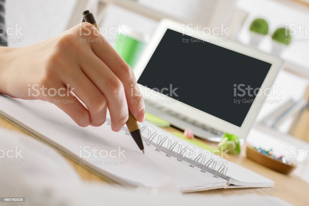 Girl writing in notepad royalty-free stock photo