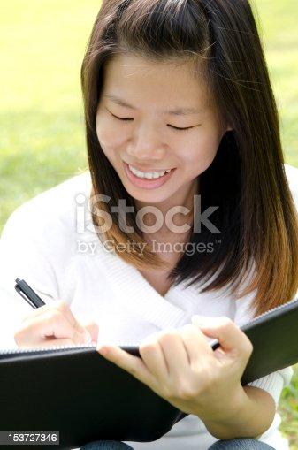 istock Girl writing 153727346