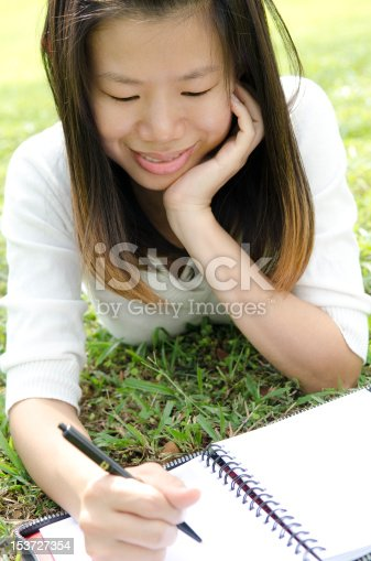 istock Girl writing 153727354