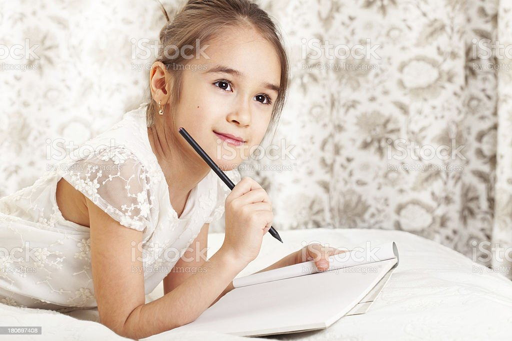 Girl writing royalty-free stock photo