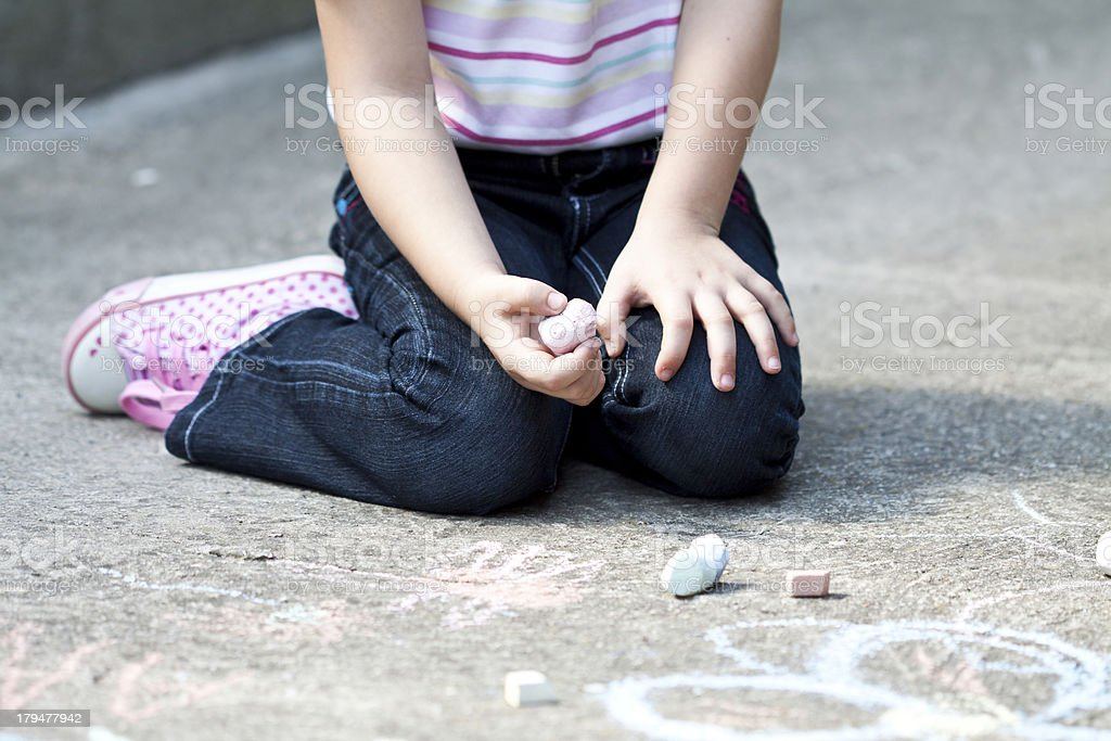Girl writing with chalk royalty-free stock photo