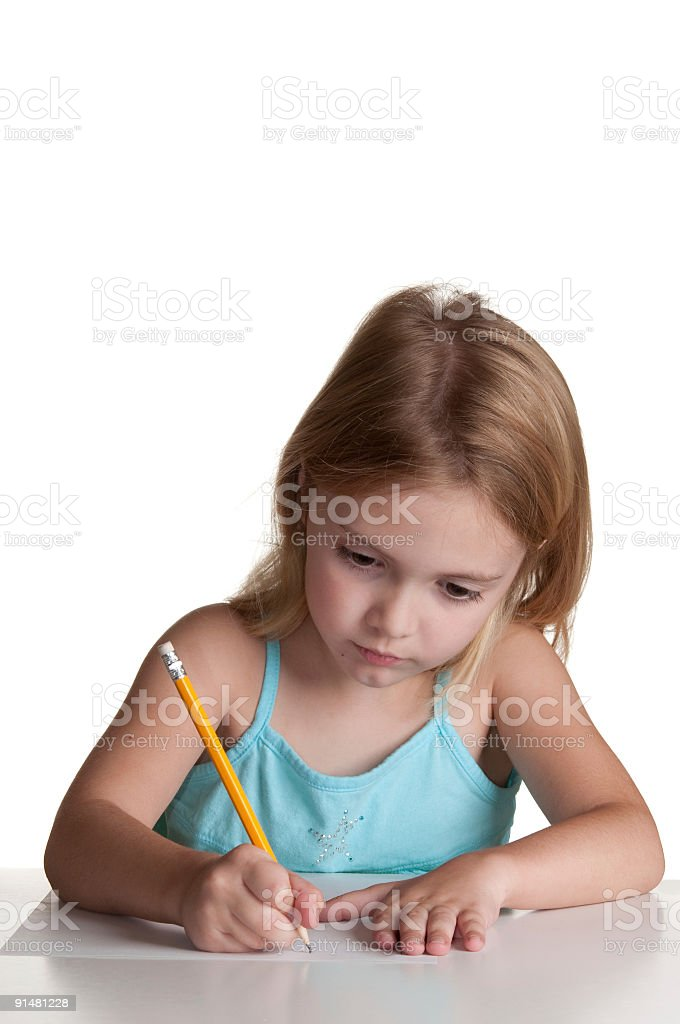 Girl writing with pencil on paper. stock photo
