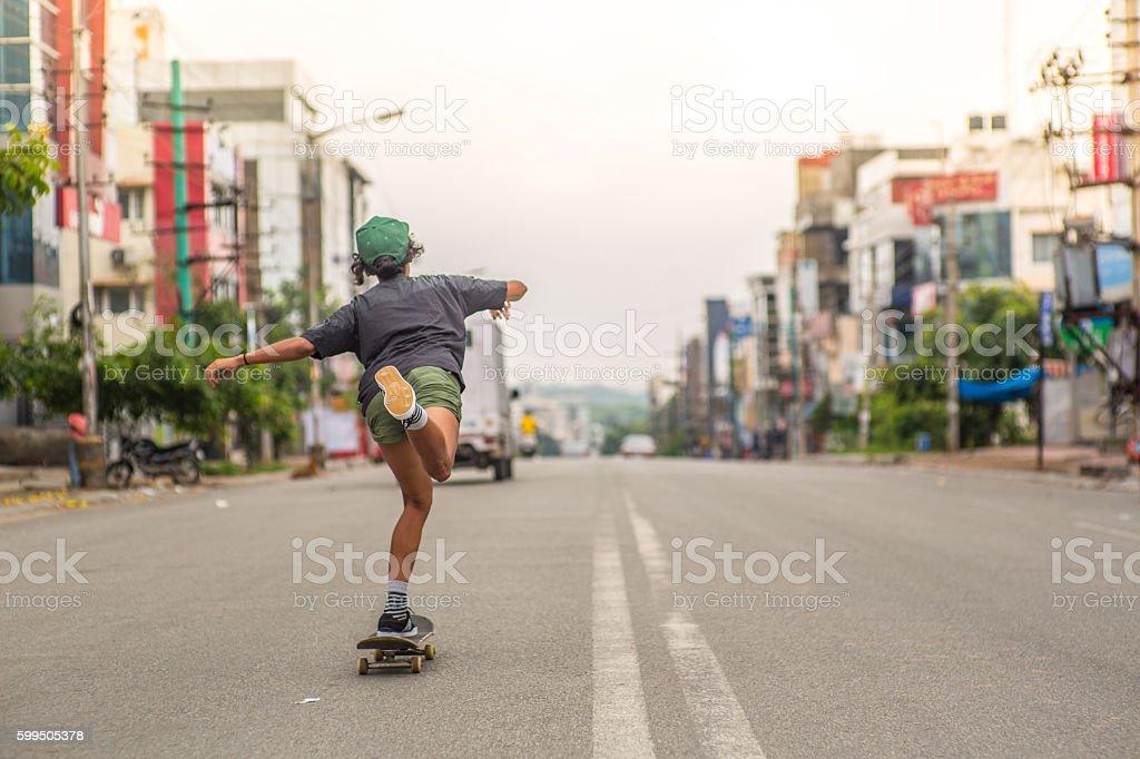 Girl_skateboard_city stock photo
