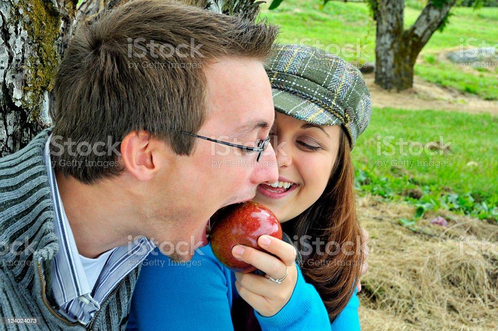 Girlfriend Feeds Apple to Boyfriend royalty-free stock photo