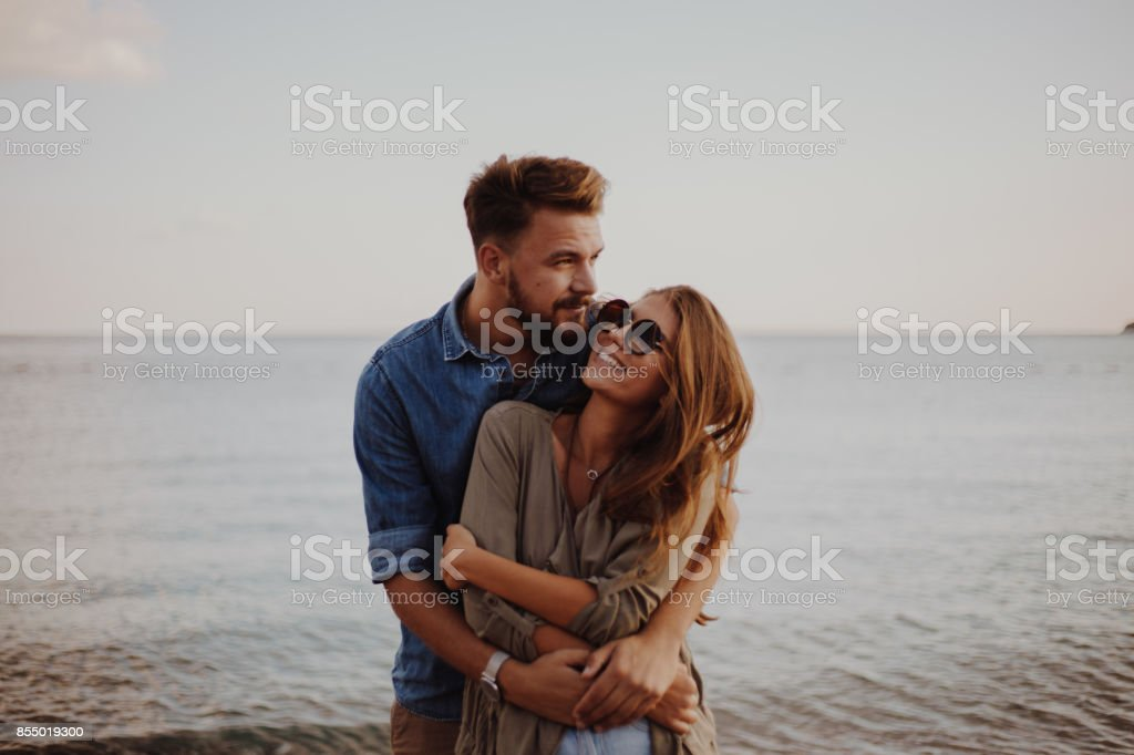 Girlfriend feeling safe in her boyfriends arms stock photo