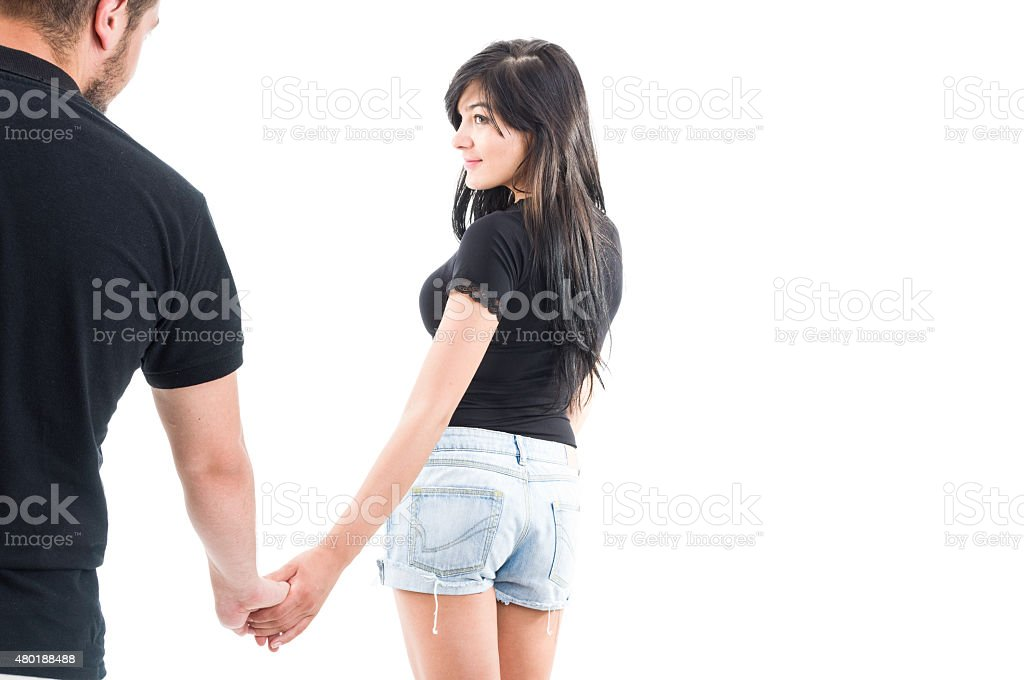 Girlfriend leaving or inviting to go together stock photo