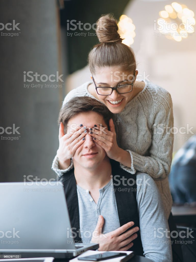 Girlfriend making her boyfriend surprise and closing eyes royalty-free stock photo
